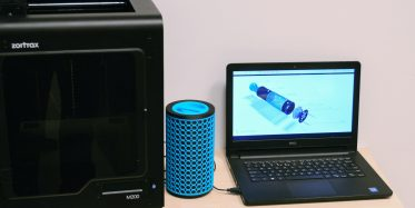 Blue 3D printed device with Zortrax M200 and notebook