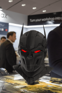 Black 3D printed mask with red eyes