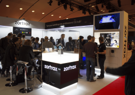 A Zortrax platform surrounded by crowd at a technology fair
