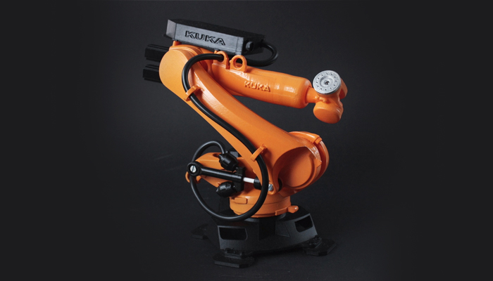 Orange kuka's machine with black elements