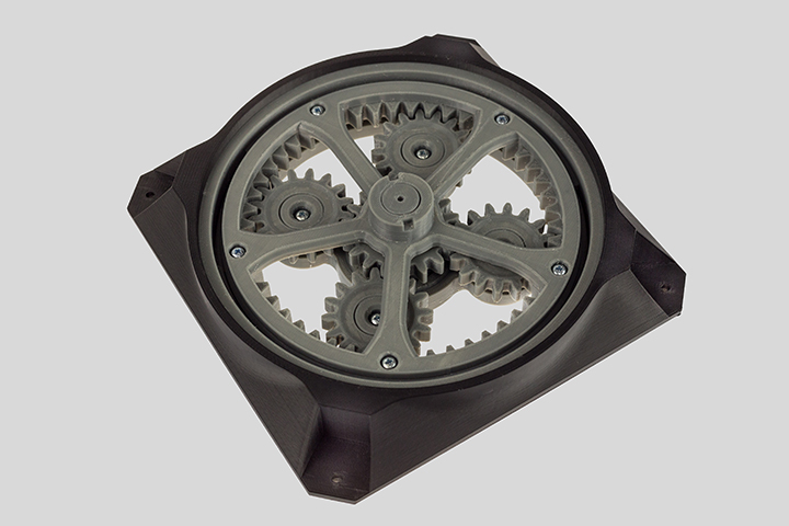 Small gray 3D printed gears by Zortrax