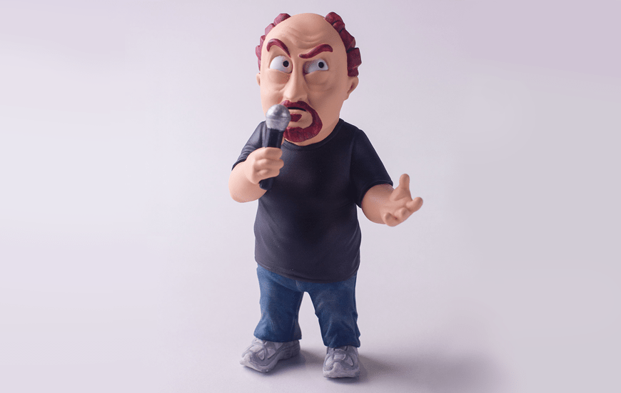 3D printed figurine of man in a black t-shirt holding a microphone by Zortrax