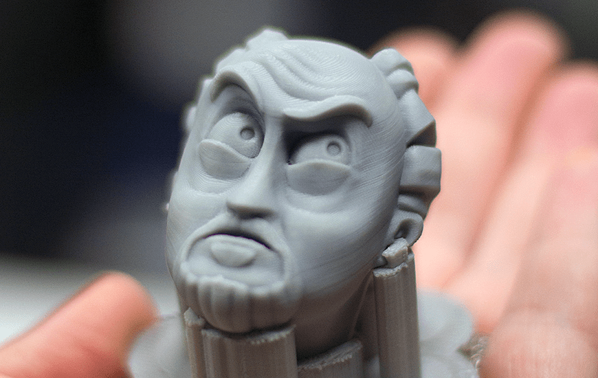 Small model of 3D face lying on hand
