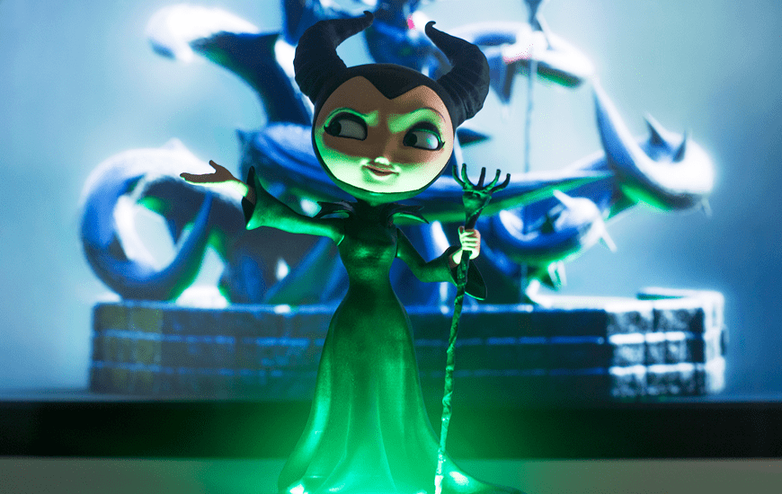 3D printed toy of a green witch with a raised hand by Zortrax