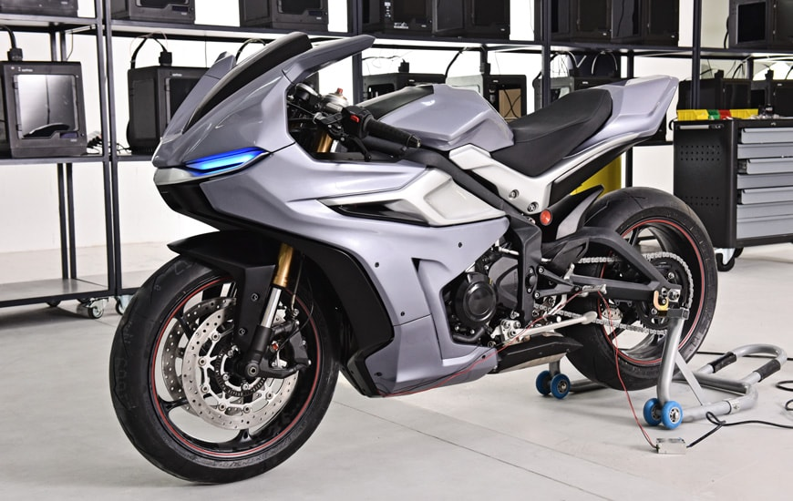 SIlver motorcycle with 3D printed parts on Zortrax Printer