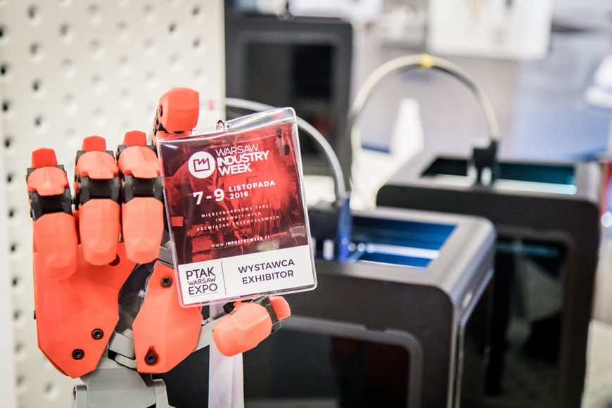 Red robot hand with the Zortrax's 3D printers in background