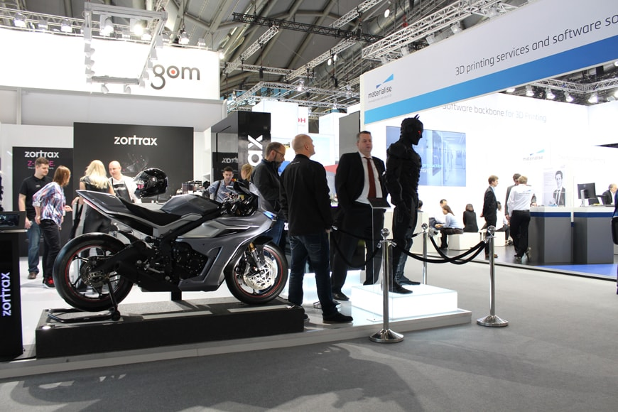 Zortrax's stand with a 3D silver bike and black statue