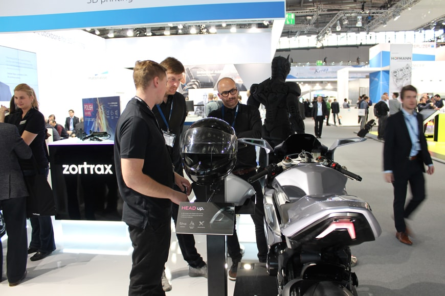 Zortrax's technology stand with motorcycle and helmet