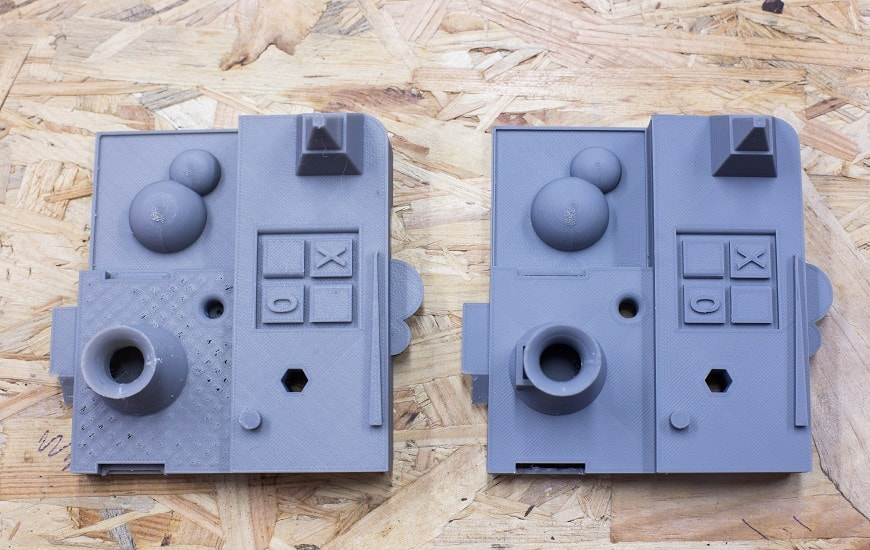 Two gray 3D models printed by Zortrax